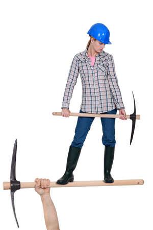 Photo pour Woman with a pickaxe - image libre de droit