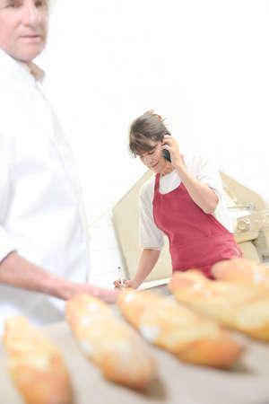 Photo pour Chopsticks, baker and shop assistant - image libre de droit