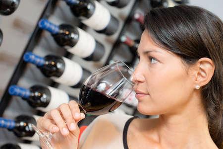 Photo pour Brunette smelling wine - image libre de droit