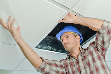 Peering under a ceiling panel