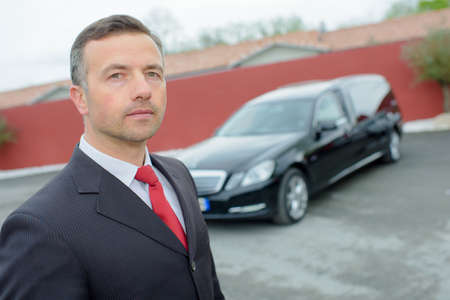 funeral director with car