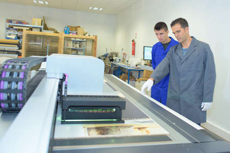 Two men in professional printing works