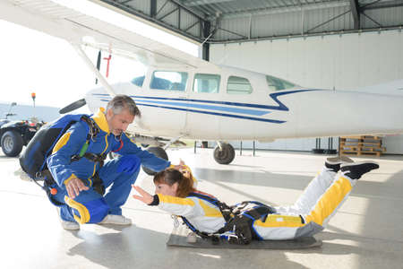 Woman practicing position for parachute jump