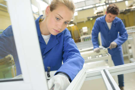 Photo for Young people working in window factory - Royalty Free Image