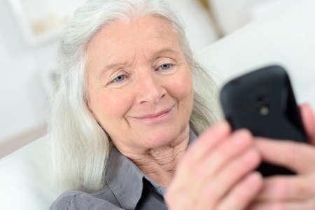 Photo pour grandmother talking on mobile phone - image libre de droit