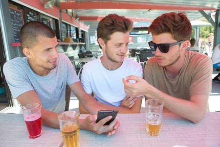 Photo pour man group in bar taking selfie photo - image libre de droit
