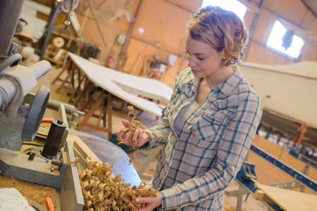 woman carpenter with wood shavings