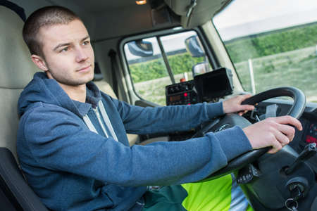 Photo pour Young man driving lorry - image libre de droit