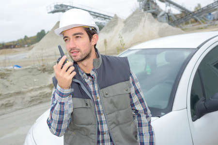 Photo pour Man communicating via walkie talkie - image libre de droit