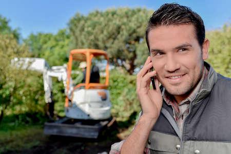 Photo pour man having a call in a field - image libre de droit