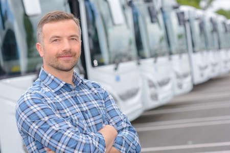 Photo pour Portrait of man with fleet of buses - image libre de droit