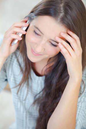 Photo pour Woman looks worried during phone call - image libre de droit