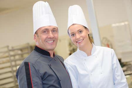 Photo pour portrait of a chef with his commis chef - image libre de droit