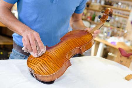 wiping a violin
