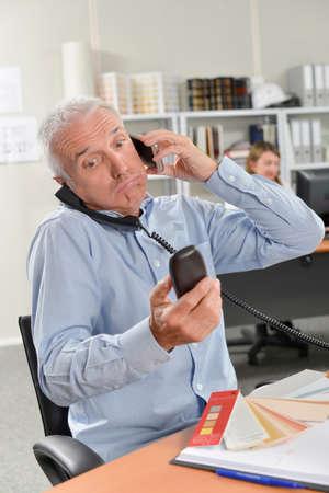 Photo pour Overworked boss on the phone - image libre de droit