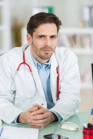 Photo pour close-up male doctor portrait in his office - image libre de droit
