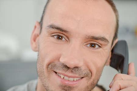 Photo pour Close-up of a man on the phone - image libre de droit