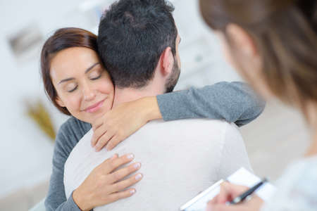 Photo for young happy couple after therapy session with psychologist - Royalty Free Image