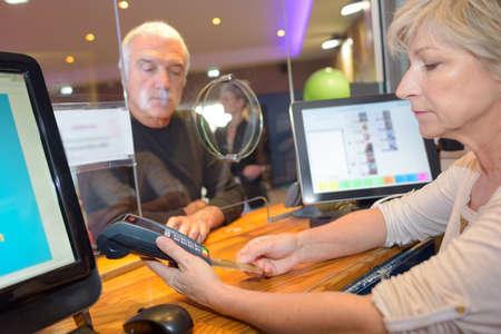 Photo pour customer getting cash out from bank cashier - image libre de droit
