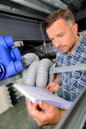 Man installing a new ventilation system