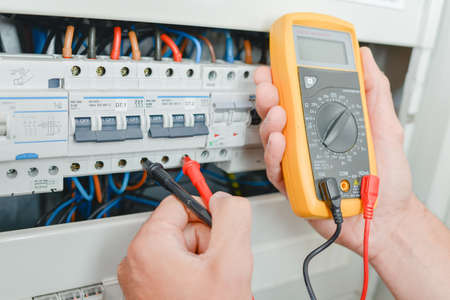 Photo for Probes of multimeter in fusebox - Royalty Free Image