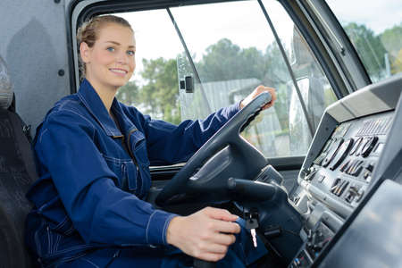 Photo pour Woman in driving seat of heavy goods vehicle - image libre de droit