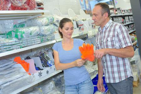 Couple shopping, woman wearing glove