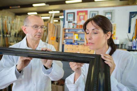 Photo pour People working on picture frame - image libre de droit