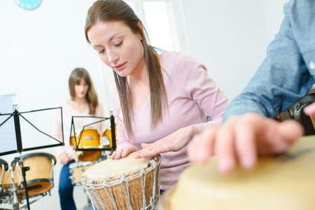 Music rehearsal, woman playing bongos