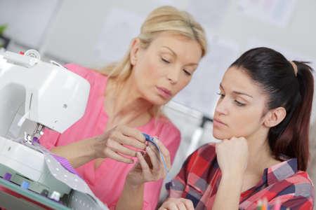 Photo pour two women working in a tailor shop - image libre de droit