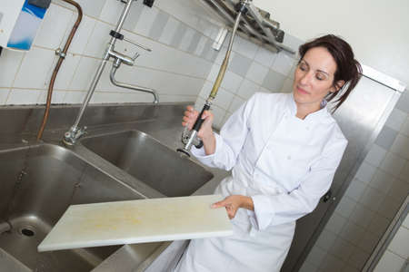two hands washing chooping board