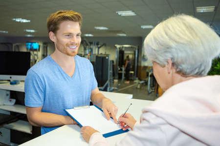 senior inquiring in the gym