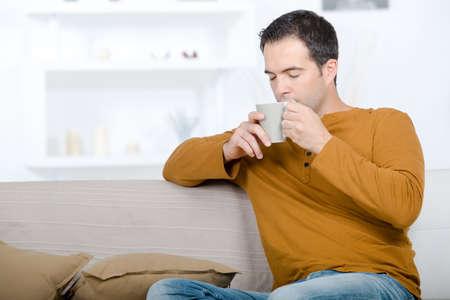 Photo pour man drinking coffee chilling relax concept - image libre de droit