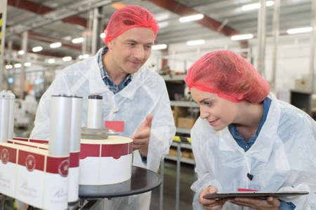 bottling company employees monitoring lebeling process