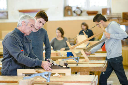 Photo pour student and teacher in carpentry class - image libre de droit