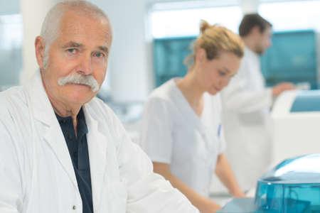 Photo pour portrait of confident senior doctor - image libre de droit