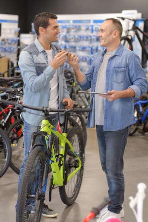 man purchasing a bike