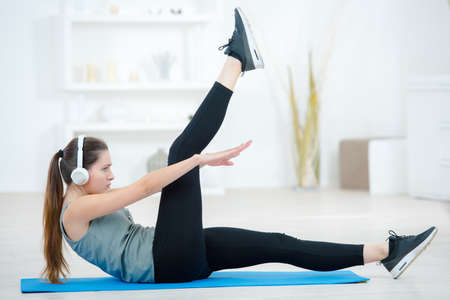 A woman exercising in the house