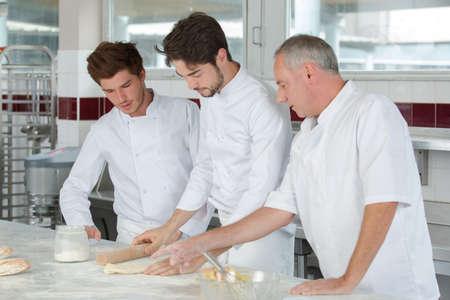 Photo pour chef with apprentices at work - image libre de droit