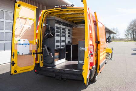 Foto de Rear view of mobile van workshop with doors open - Imagen libre de derechos
