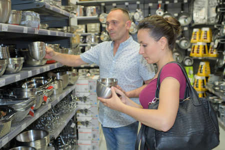 couple buying at a kitchen store