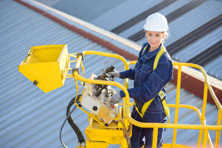 Photo for female construction worker on site in hydraulic lifting ramp - Royalty Free Image