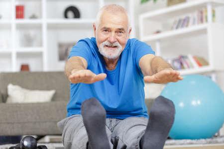 Photo pour senior man stretching legs - image libre de droit