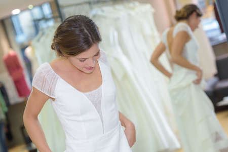 Photo pour woman fitting a wedding gown - image libre de droit