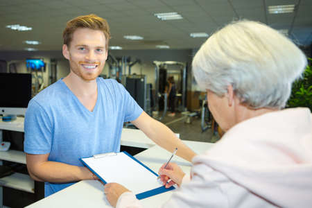 Photo for elderly woman registering at fitness center - Royalty Free Image