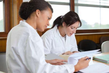 Photo pour 2 doctors working in office of hospital - image libre de droit