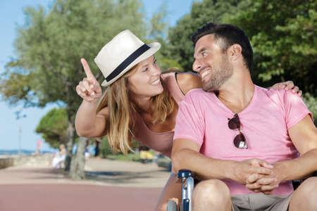 Photo pour young couple in wheelchair enjoying time outdoors - image libre de droit