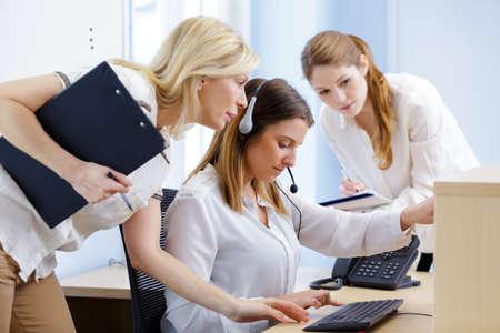 Photo pour woman training to use switchboard - image libre de droit