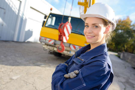 Photo pour posing with a heavy equipment at the background - image libre de droit