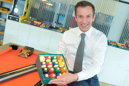 Photo pour professional billiard player showing billiard balls - image libre de droit